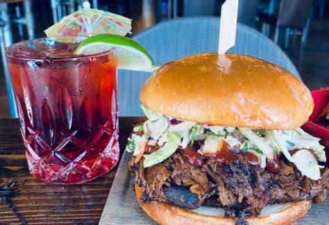 Pulled Pork Sandwich and Drink at Alleys Alehouse