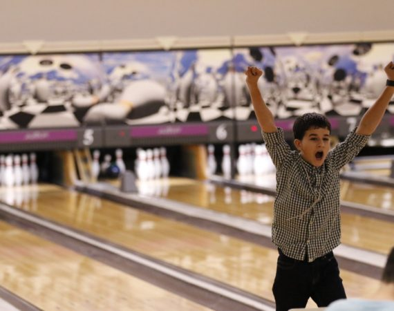 Excited Youth Bowler